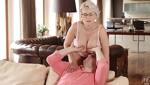 Super hot young granny with gigantic tits Promoter Wicky fucks young man in the conscious of room