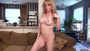 Elizabeth Green plays with her large fake boobs and juicy pussy